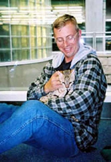 military cat Pfc Hammer with Staff Sgt Bousfield